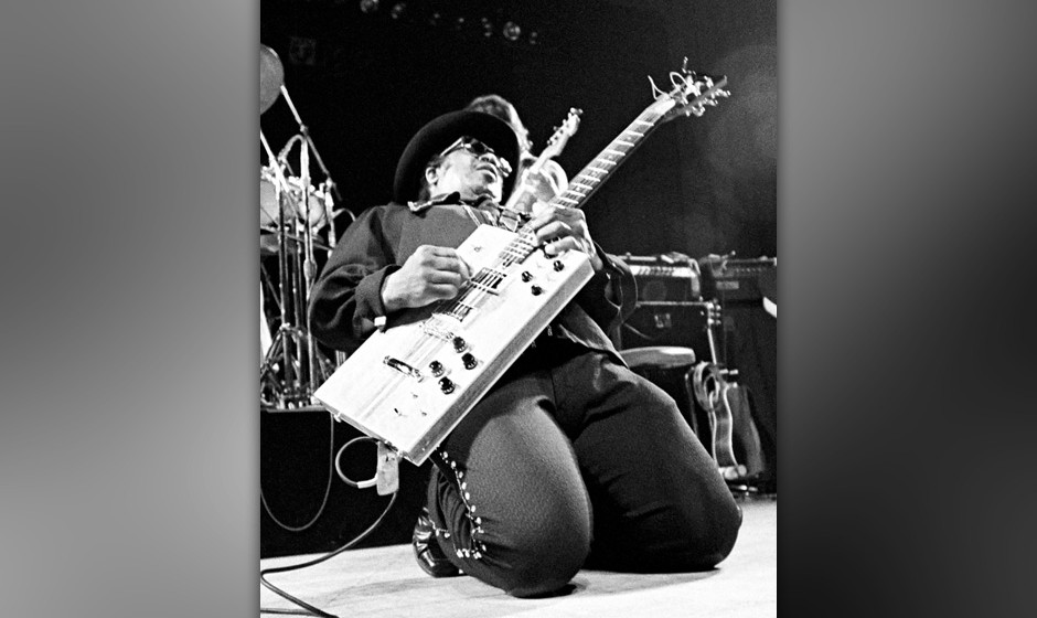UNITED STATES - FEBRUARY 07:  BERKELEY  Photo of Bo DIDDLEY, Bo Diddley performing on stage, rectangular guitar, on knees, fu