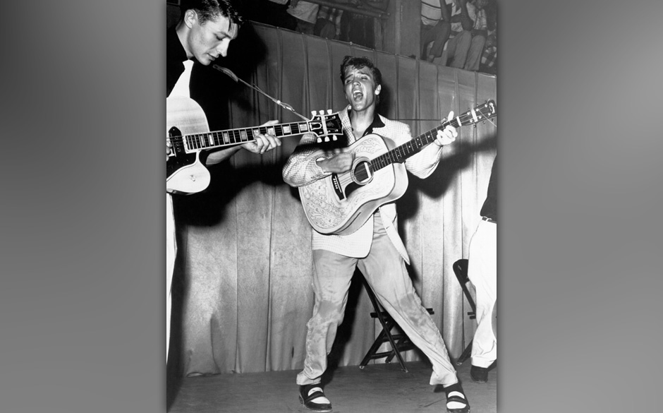 Elvis Presley, 1956, Unknown location. Left Scotty Moore, Right Bill Black.