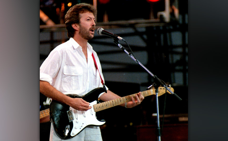UNITED STATES - JULY 13:  Photo of LIVE AID and Eric CLAPTON; performing live onstage at Live Aid, playing 'Blackie' Fender S