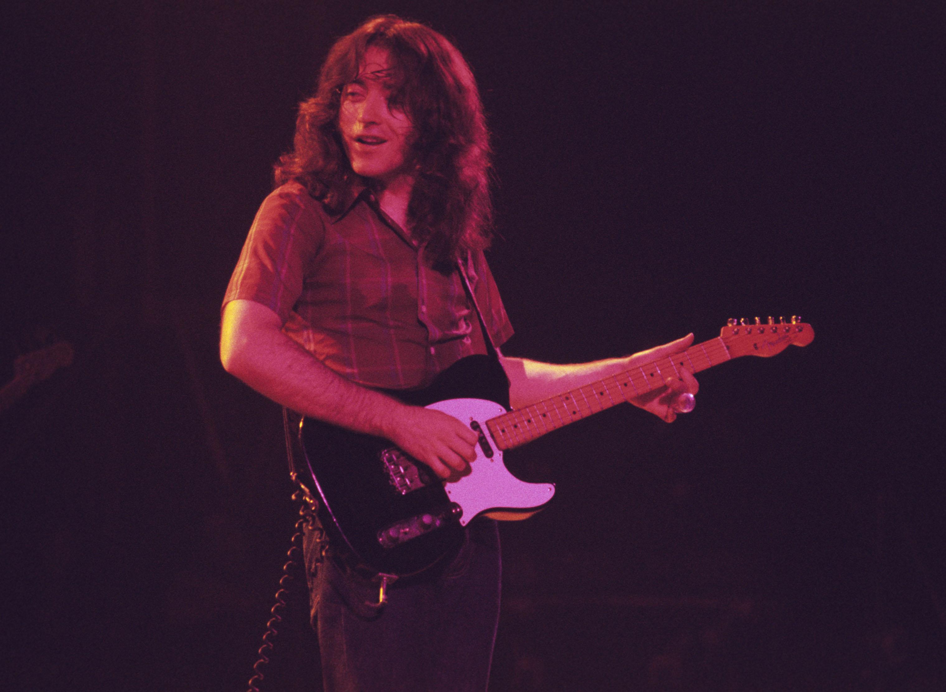 ATLANTA, GA - February 8: Irish blues guitarist Rory Gallagher performs at the Omni Coliseum on February 8, 1976 in Atlanta,