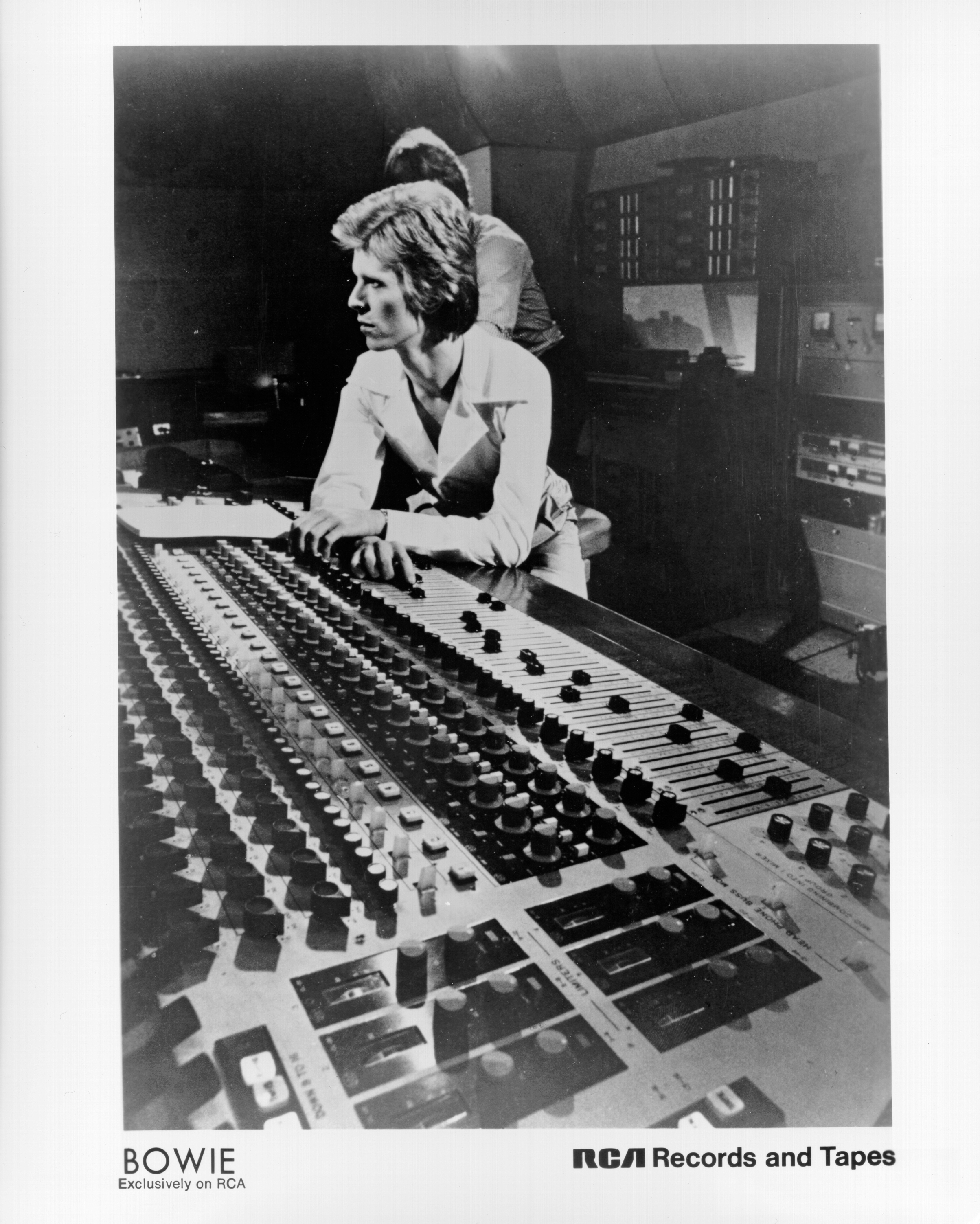 CIRCA 1975:  Musician David Bowie sits at the console mixing board in a studio in circa 1975. (Photo by Michael Ochs Archives