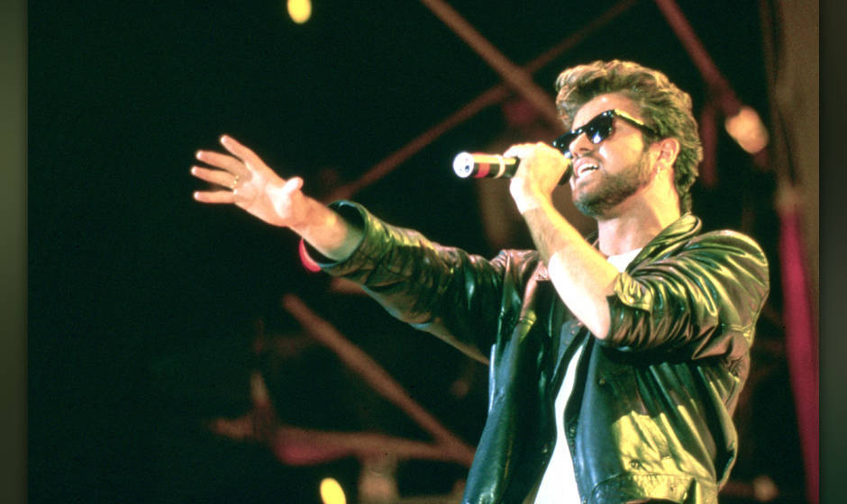 George Michael and Wham performing live at the Live Aid Concert, Wembley Stadium, London on 13th July 1985.;  (Photo by Steve