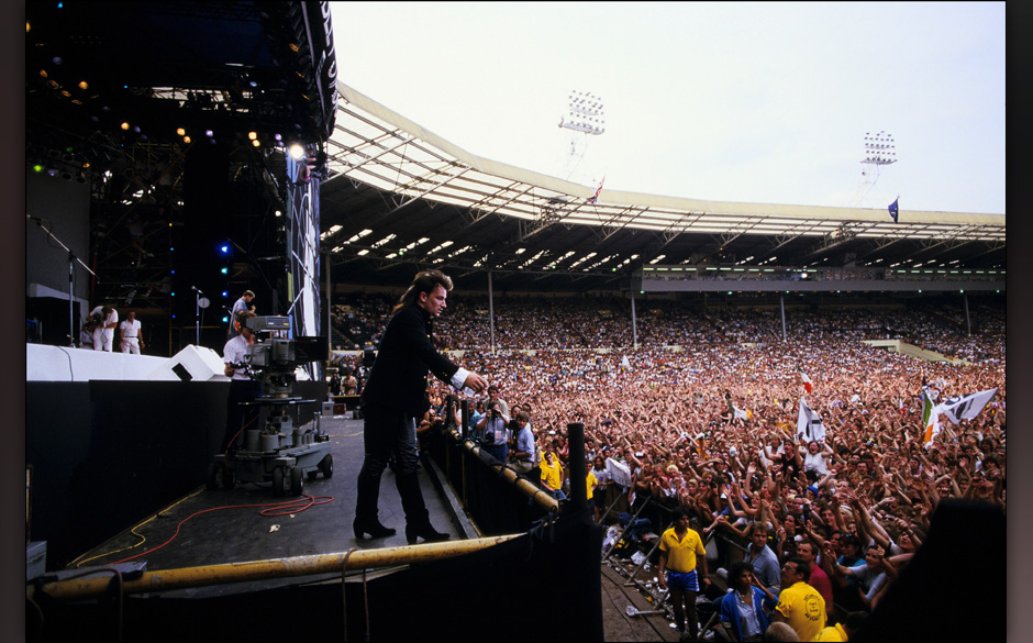 LONDON - JULY 13: Bono performs on stage during the Live Aid concert at Wembley Stadium on 13 July, 1985 in London, England.