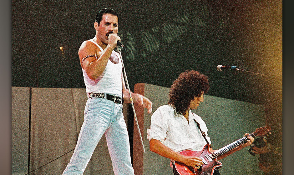 LONDON, UNITED KINGDOM - JULY 13: Freddie Mercury of Queen performs on stage at Live Aid on July 13th, 1985 in Wembley Stadiu