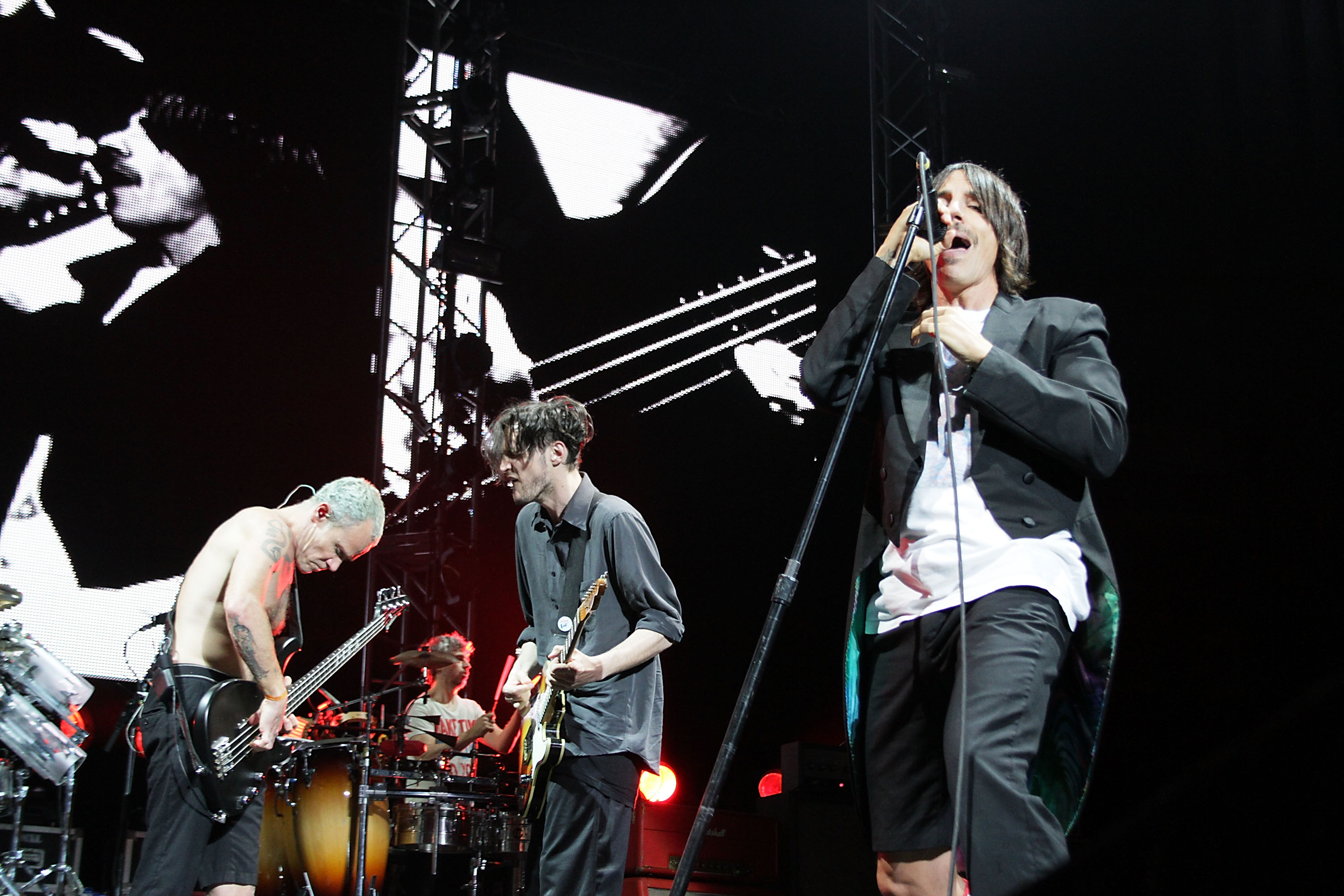 SAN JUAN, PUERTO RICO - APRIL 06:  (L-R) Flea, Josh Klinghoffer and Anthony Kiedis of Red Hot Chili Peppers perform at Colise