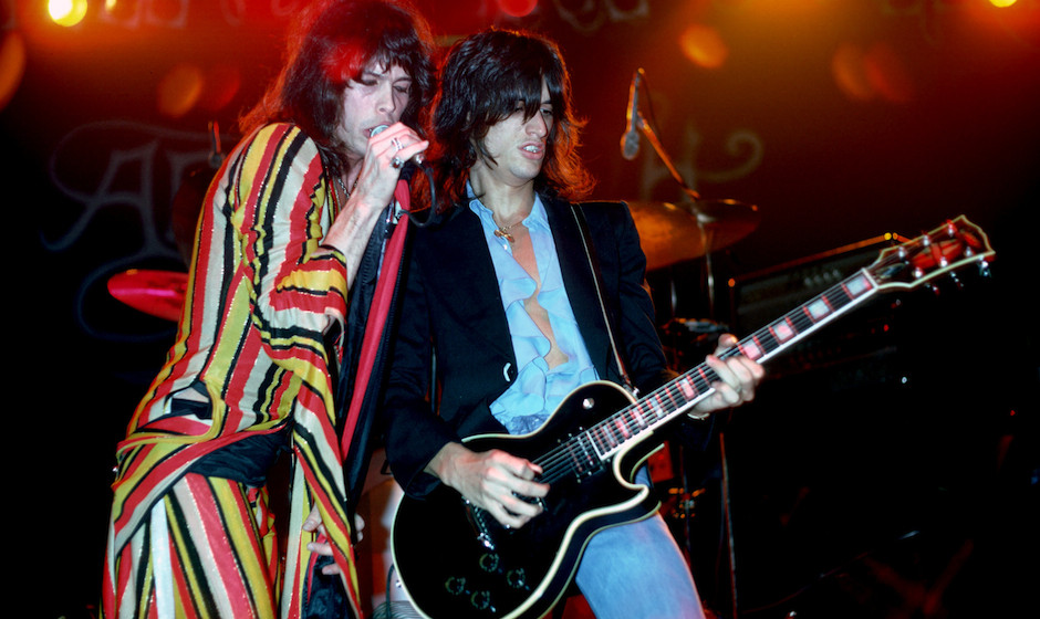 UNITED STATES - DECEMBER 01:  Photo of AEROSMITH; Steven Tyler and Joe Perry (playing Gibson Les Paul guitar) performing live