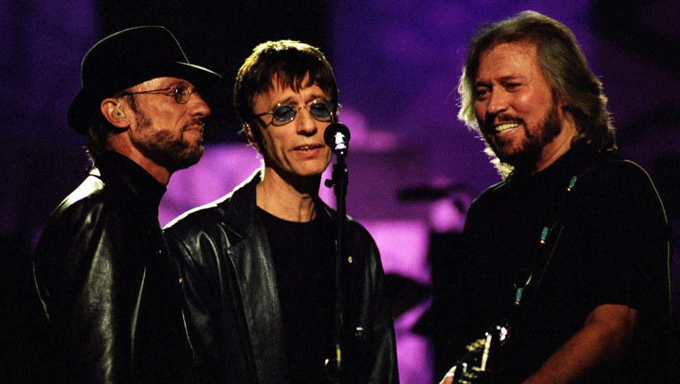Musicians Maurice Gibb, Robin Gibb and Barry Gibb of the Bee Gees perform onstage at the Hammerstein Ballroom on April 27, 20
