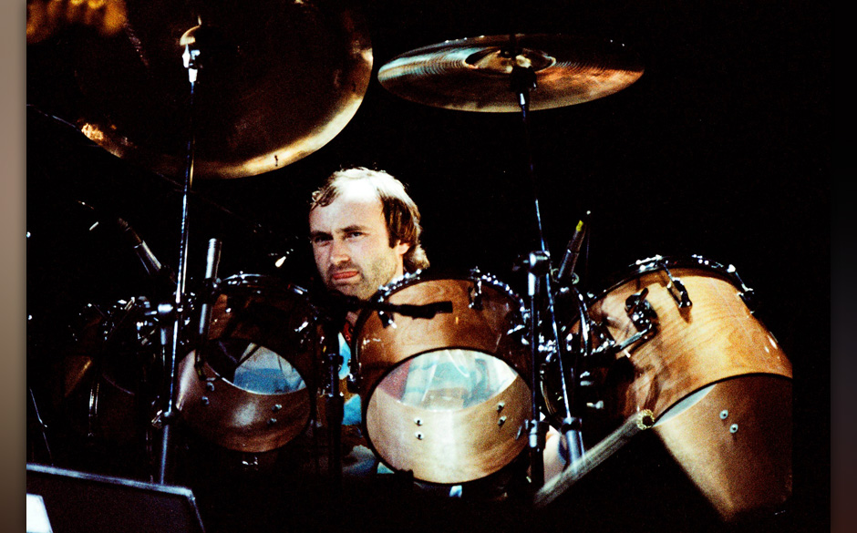 MILTON KEYNES, ENGLAND - OCTOBER 2: Phil Collins on stage performing with Genesis at the reunion concert 'Six of the Best' at
