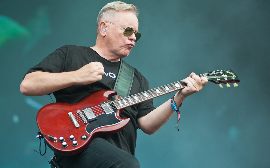 CHICAGO, IL - AUGUST 02:  Bernard Sumner of New Order performs during Lollapalooza 2013 at Grant Park on August 2, 2013 in Ch