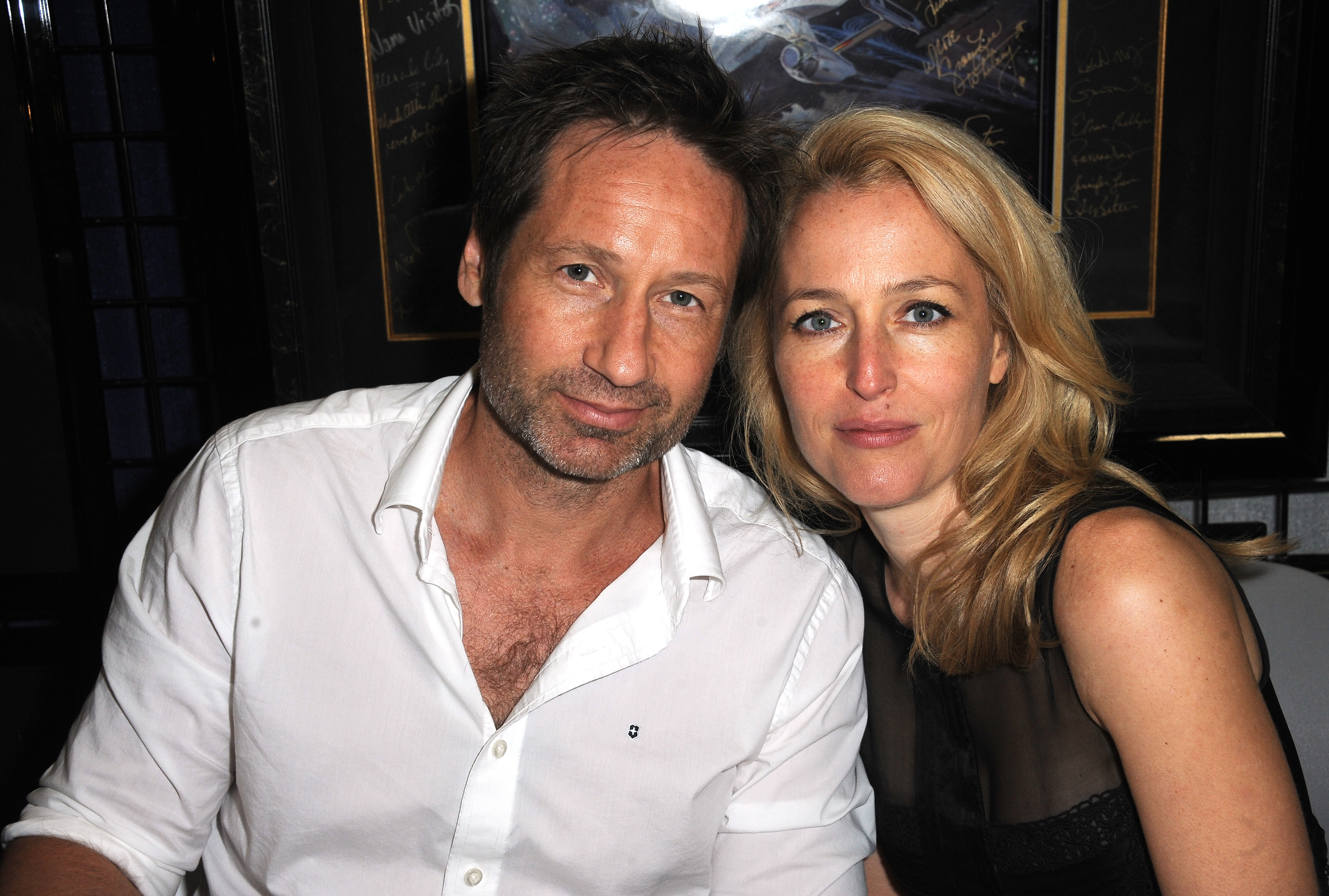 SAN DIEGO, CA - JULY 18:  Actor David Duchovny and Gillian Anderson of 'The X-Files'  sign autographs at the LightSpeed Booth