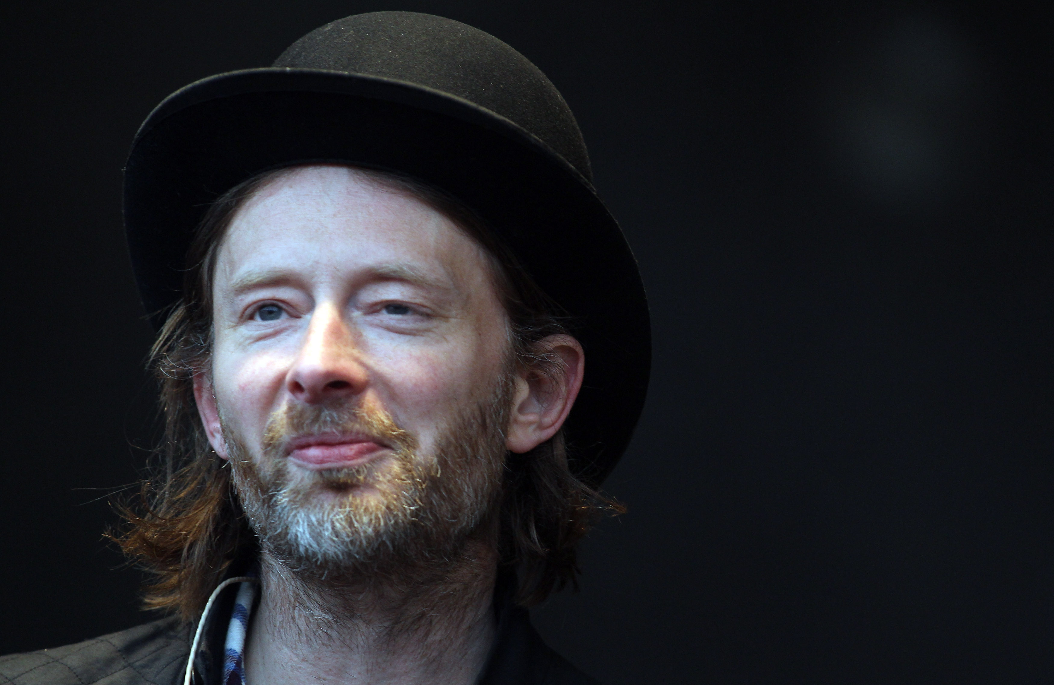 GLASTONBURY, ENGLAND - JUNE 24:  Thom Yorke of Radiohead performs at the Park Stage at the Glastonbury Festival site at Worth