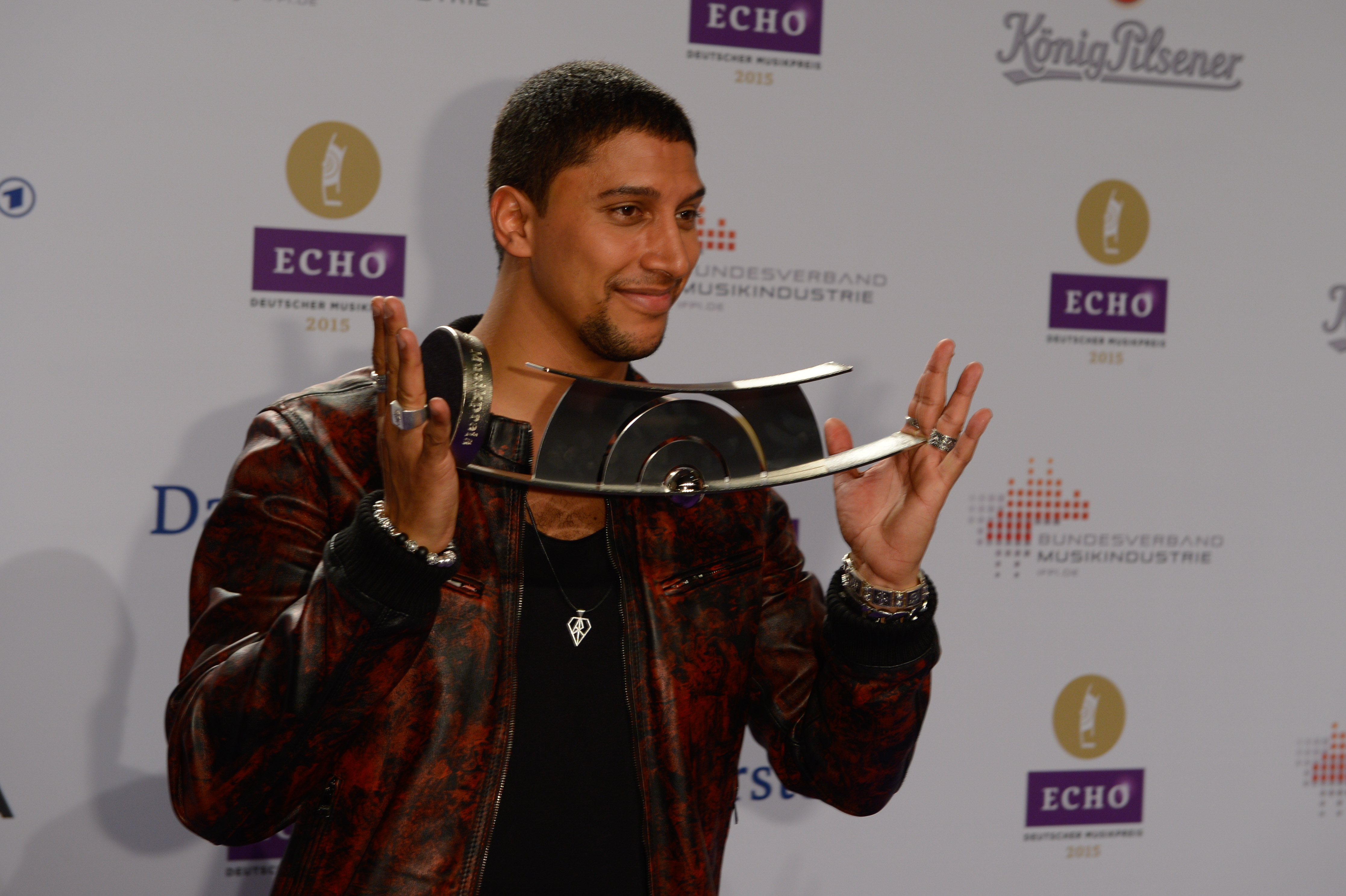 BERLIN, GERMANY - MARCH 26:  Andreas Bourani poses with his prize ( Radio Echo) at the Echo award 2014 winners board on March
