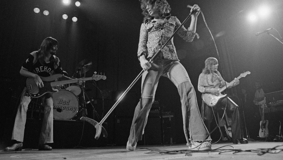 English rock group Bad Company peforming on stage, 8th April 1974. Left to right: Boz Burrell (1946 - 2006), Paul Rodgers and