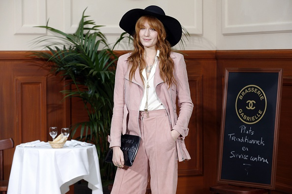 English singer Florence Welch poses before the Chanel 2015-2016 fall/winter ready-to-wear collection fashion show on March 10
