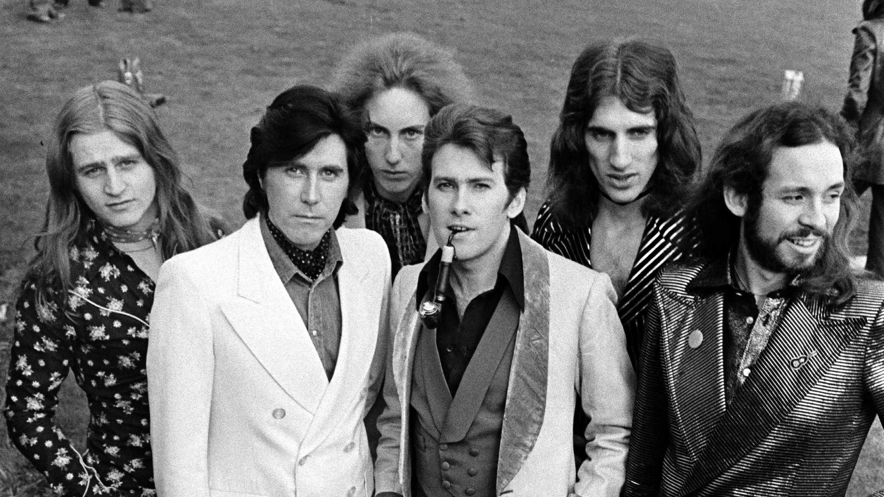 L-R Paul Thompson, Bryan Ferry, Eddie Jobson, Andy Mackay, Sal Maida and Phil Manzanera of Roxy Music pose for a group portra
