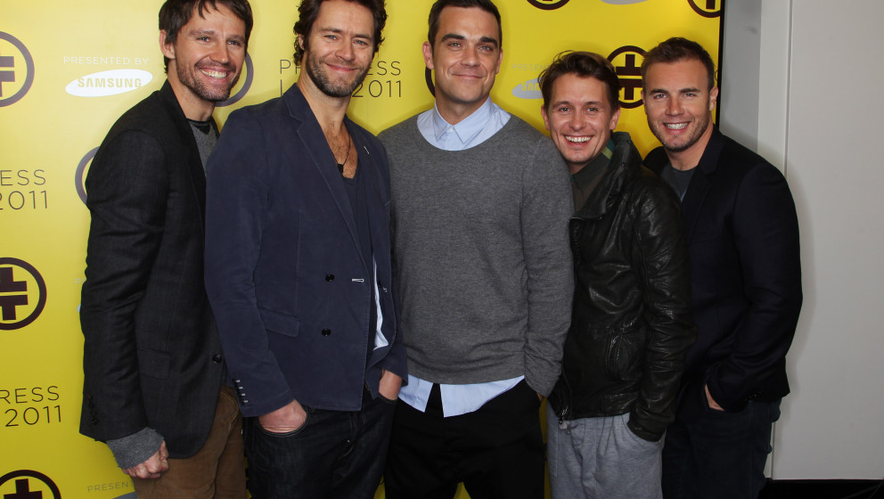 LONDON, ENGLAND - OCTOBER 26: L-R Jason Orange, Howard Donald, Robbie Williams, Mark Owen and Gary Barlow of Take That attend