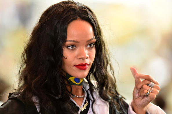 Barbadian singer Rihanna watches the 2014 FIFA World Cup final football match between Germany and Argentina at the Maracana S