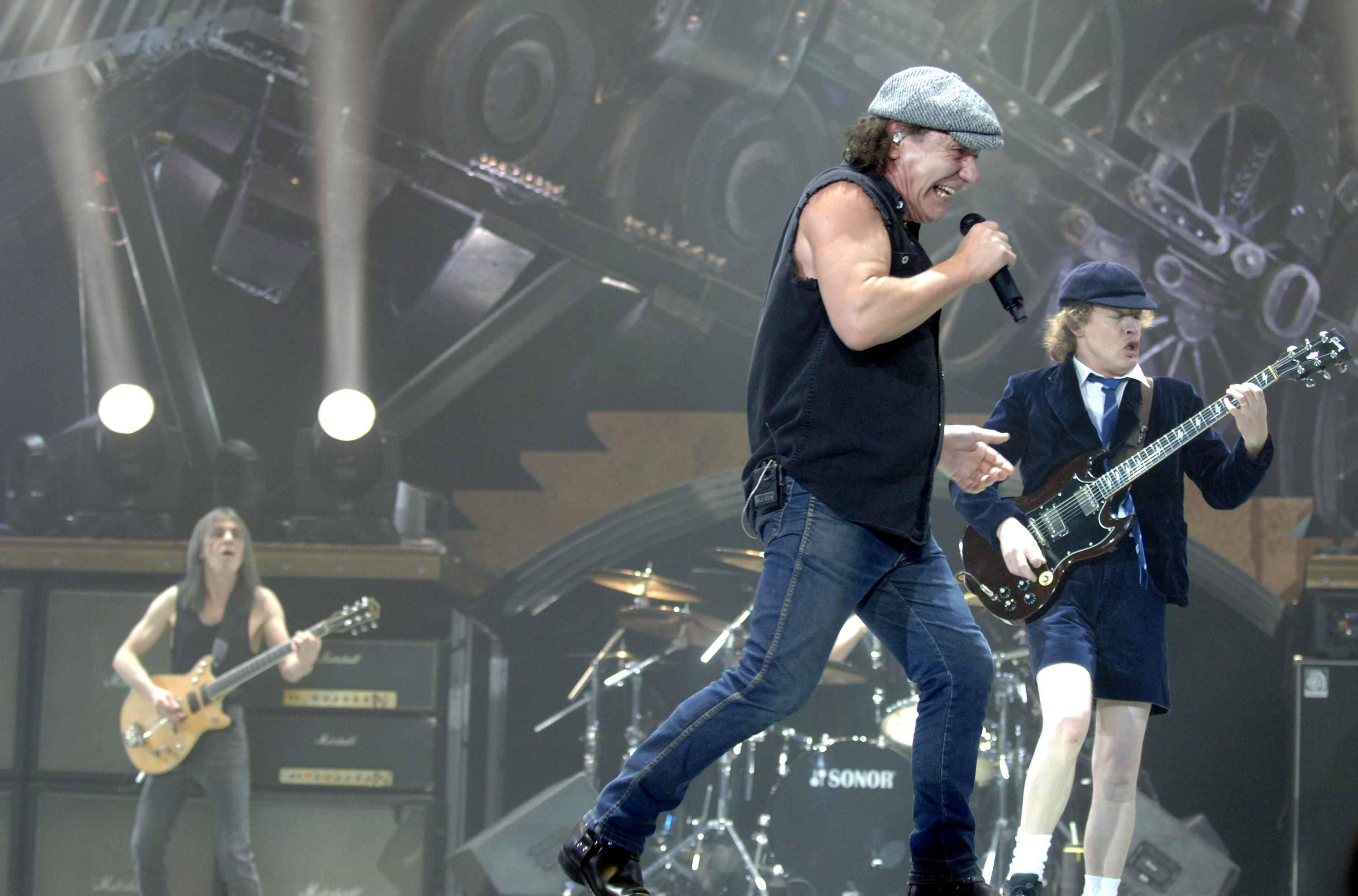 OAKLAND, CA - DECEMBER 2: (L - R) Malcolm Young, Brian Johnson, and Angus Young of AC/DC perform in support of the bands' Bla