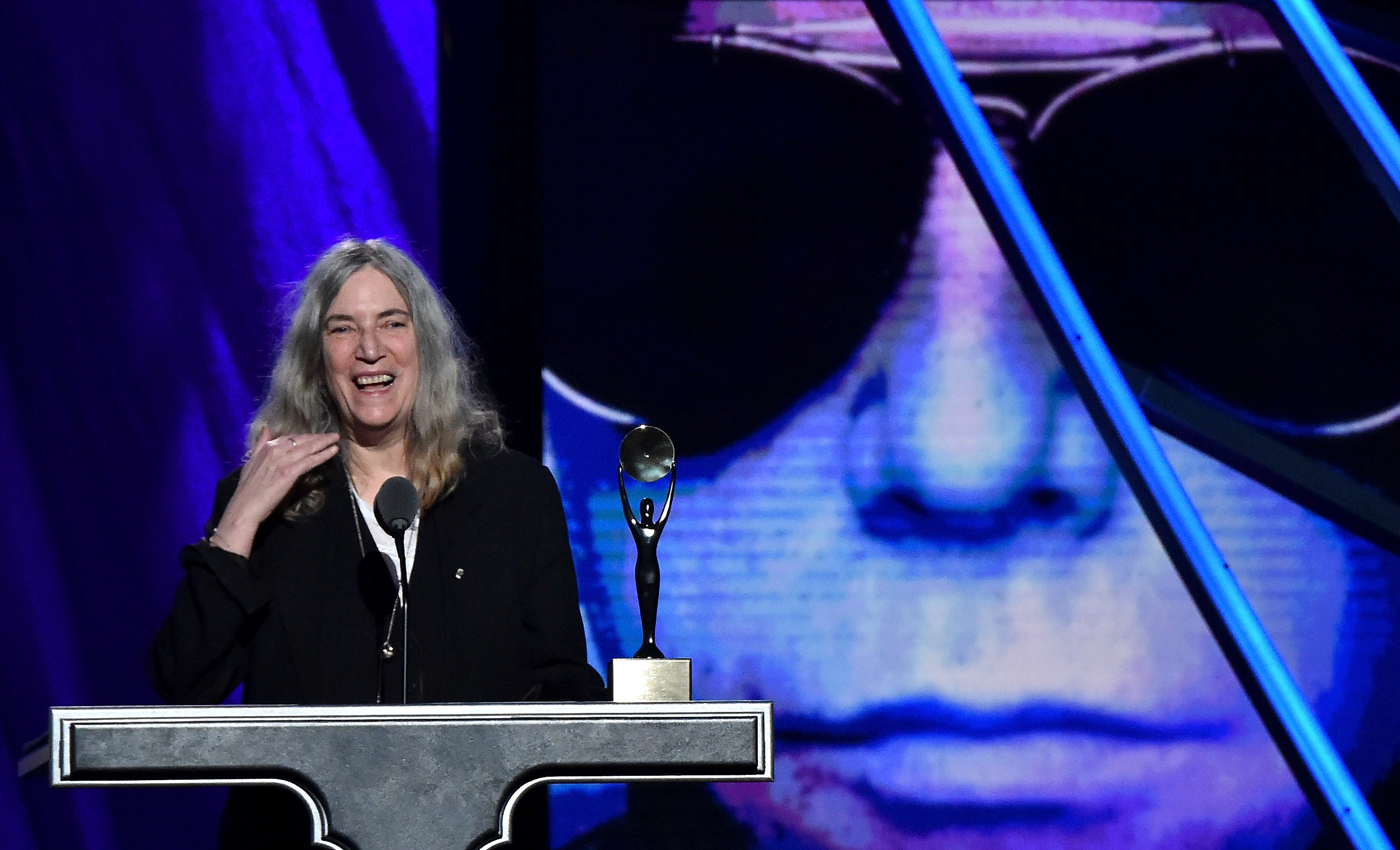 CLEVELAND, OH - APRIL 18:  Patti Smith inducts Lou Reed onstage during the 30th Annual Rock And Roll Hall Of Fame Induction C