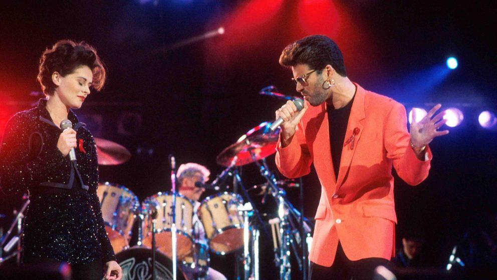 Lisa Stansfield and George Michael perform on stage with Roger Taylor of Queen at the Freddie Mercury Tribute Concert, Wemble