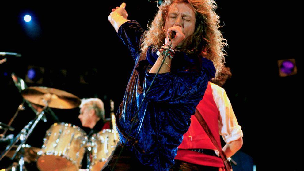 Robert Plant performing with Queen at the Freddie Mercury Tribute Concert for AIDS Awareness at Wembley Stadium, London, Apri