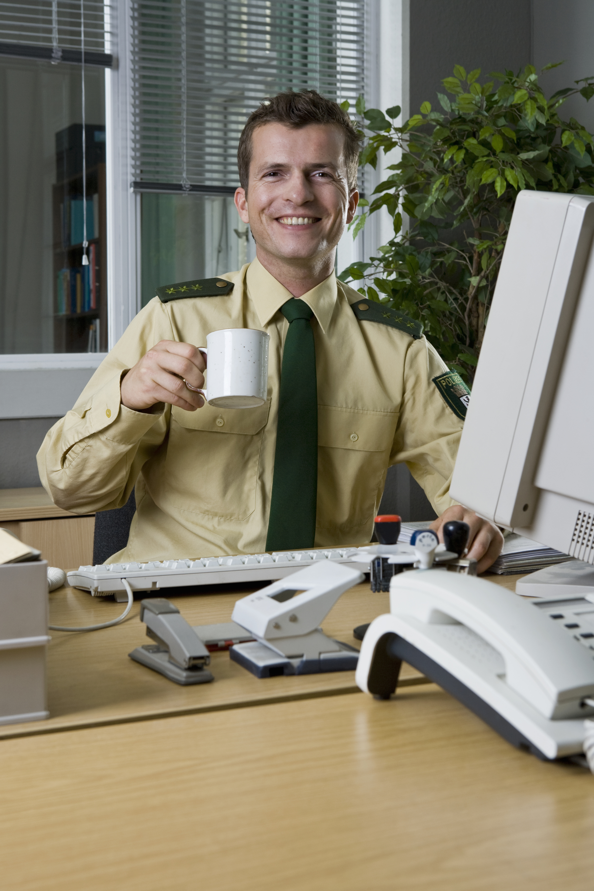 A police officer working in an office