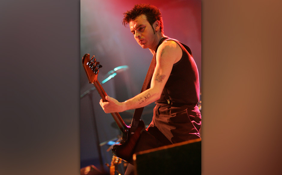 Simon Gallup of The Cure during 2004 Coachella Valley Music Festival - The Cure at Empire Polo Grounds in Indio, California,