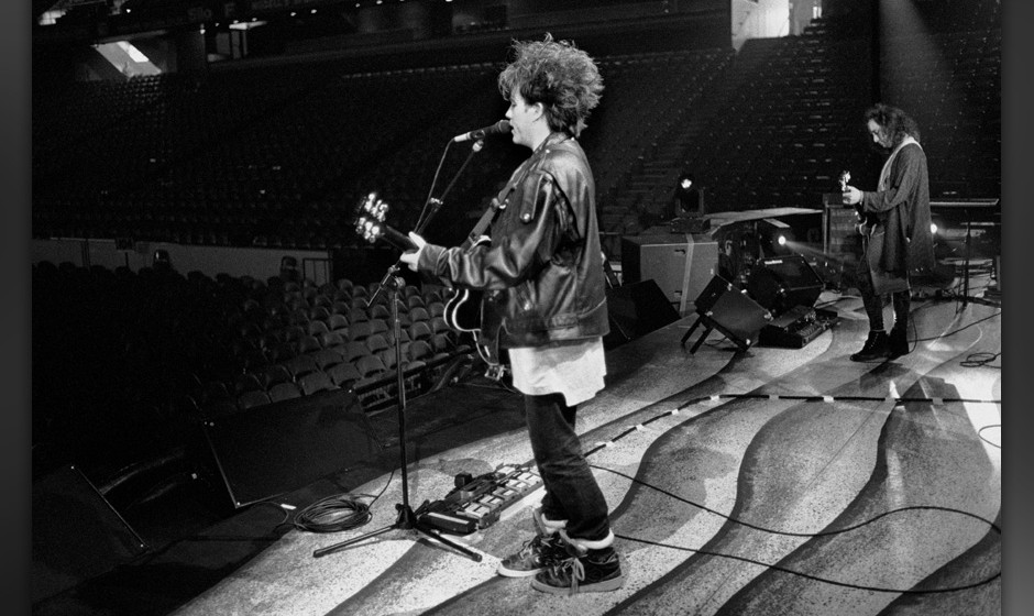 Robert Smith and Porl Thompson of The Cure viewed from the side of the stage and showing the empty auditorium during a soundc