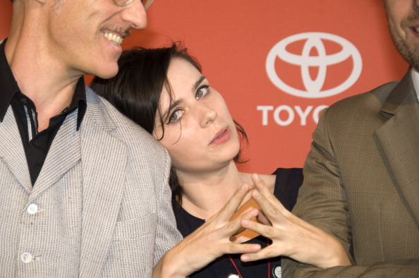 BERLIN, GERMANY - JULY 02:  German actress Nora Tschirner poses with Tom Krimi (L) and Erik Lautenschlaeger, members of her b