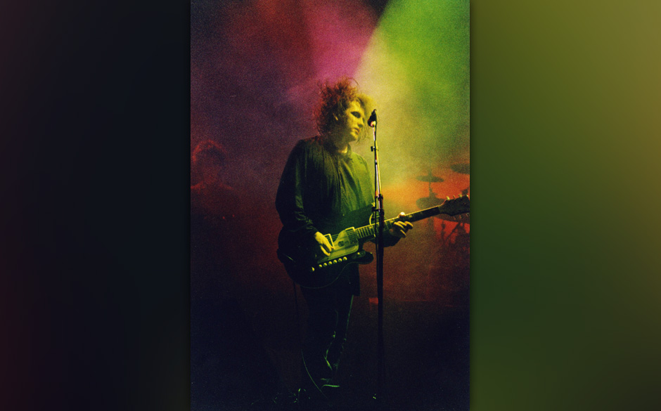 LONDON, UNITED KINGDOM - JULY 23: Robert Smith of The Cure performs on stage at Wembley Arena, on July 23rd, 1989 in London,