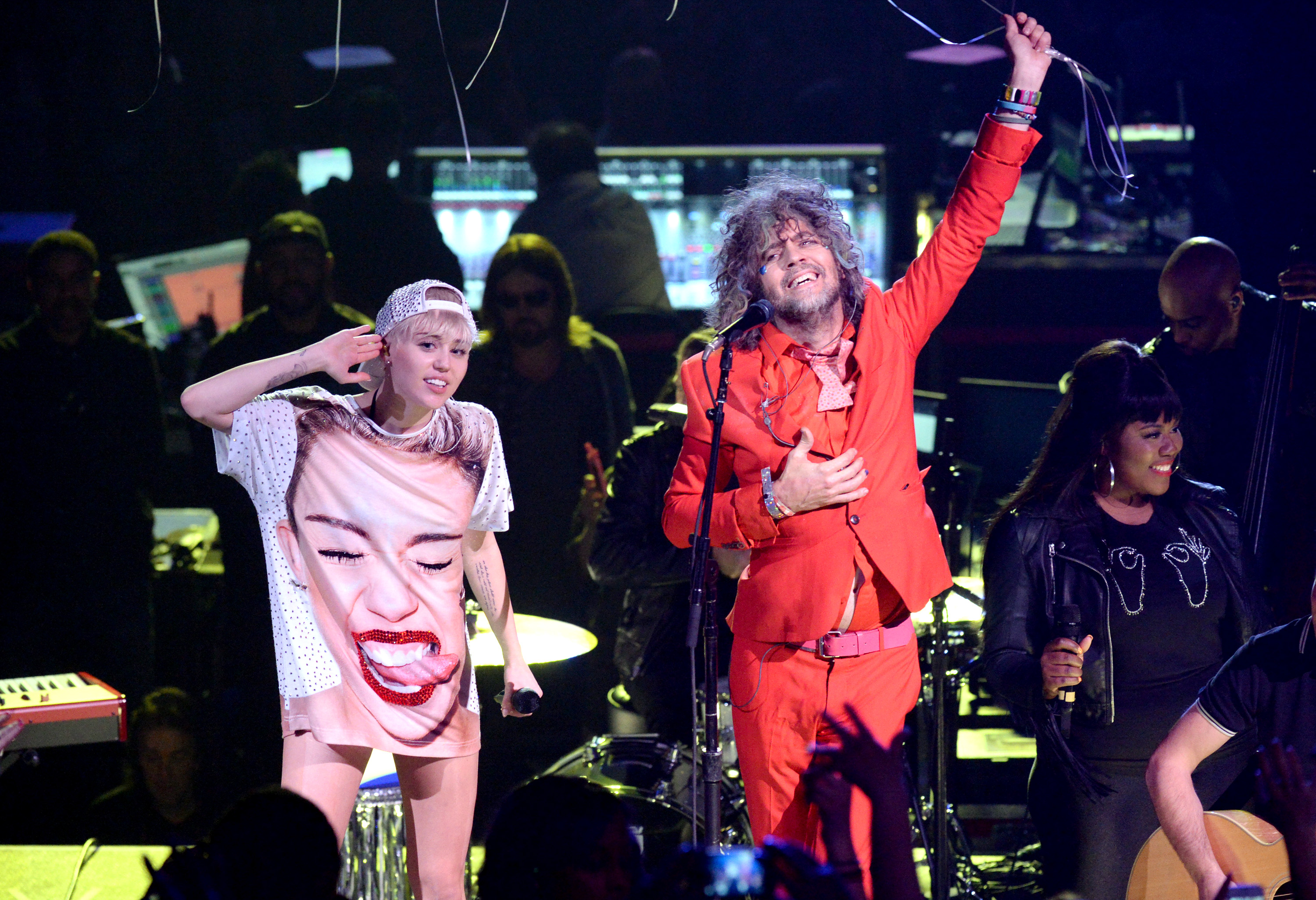 LOS ANGELES, CA - FEBRUARY 22: Miley Cyrus and Wayne Coyne perform at Staples Center on February 22, 2014 in Los Angeles, Cal