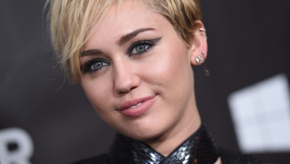 HOLLYWOOD, CA - OCTOBER 29:  Singer Miley Cyrus arrives at the 2014 amfAR LA Inspiration Gala at Milk Studios on October 29,