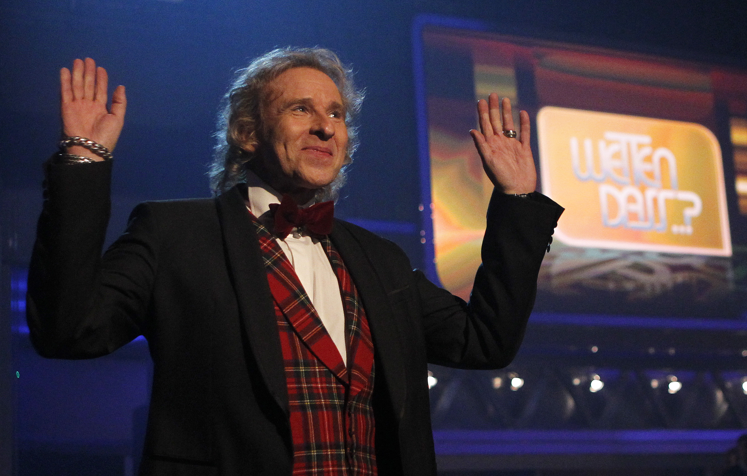 German TV show host Thomas Gottschalk gestures at the end of his last game show 'Wetten Dass' (Bet it...?) in the southern Ge