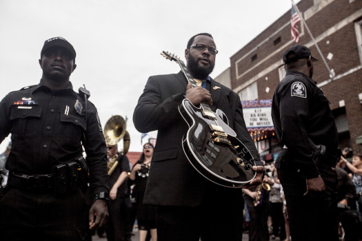 MEMPHIS, TN - MAY 27: Rodd Bland, son of blues legend Bobby Bland, carries Lucille, one of B.B. King's beloved guitars, at the front of the processional down Beale Street following the memorial in honor of B.B. King on May 27, 2015 in Memphis, TN. King passed away on May 14, 2015 at the age of 89. (Photo by Andrea Morales/Getty Images)