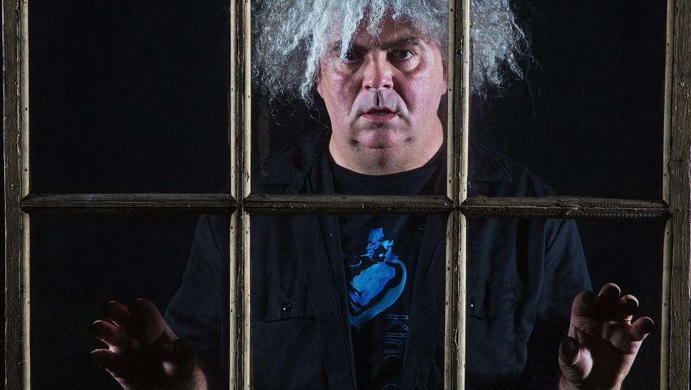 SEATTLE, WA - OCTOBER 18:  Buzz Osborne aka King Buzzo of The Melvins poses for a portrait behind a window at Showbox Market