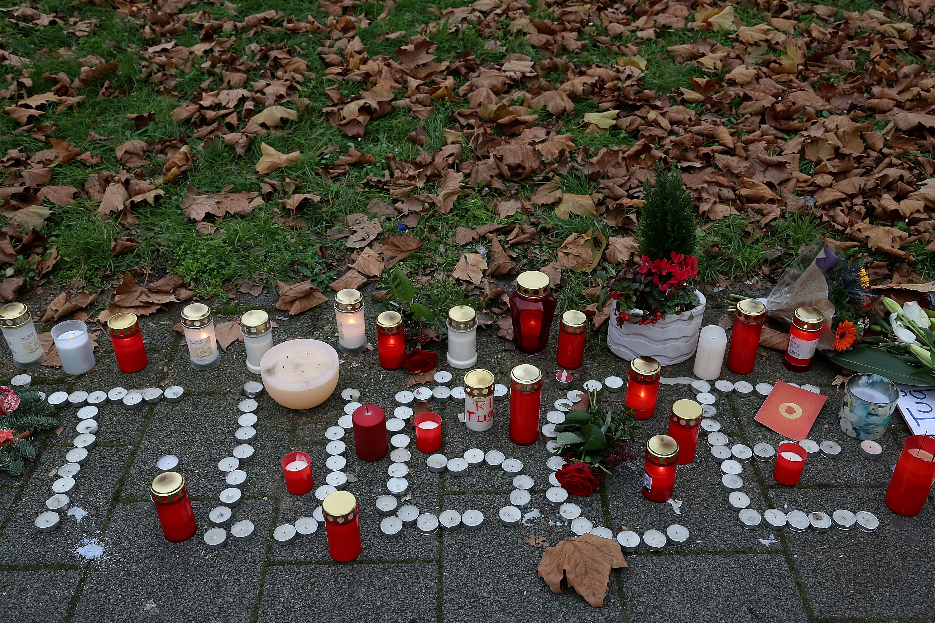 OFFENBACH, GERMANY - NOVEMBER 28:  Flowers and candles near the McDonald's restaurant where a young woman was attacked on Nov