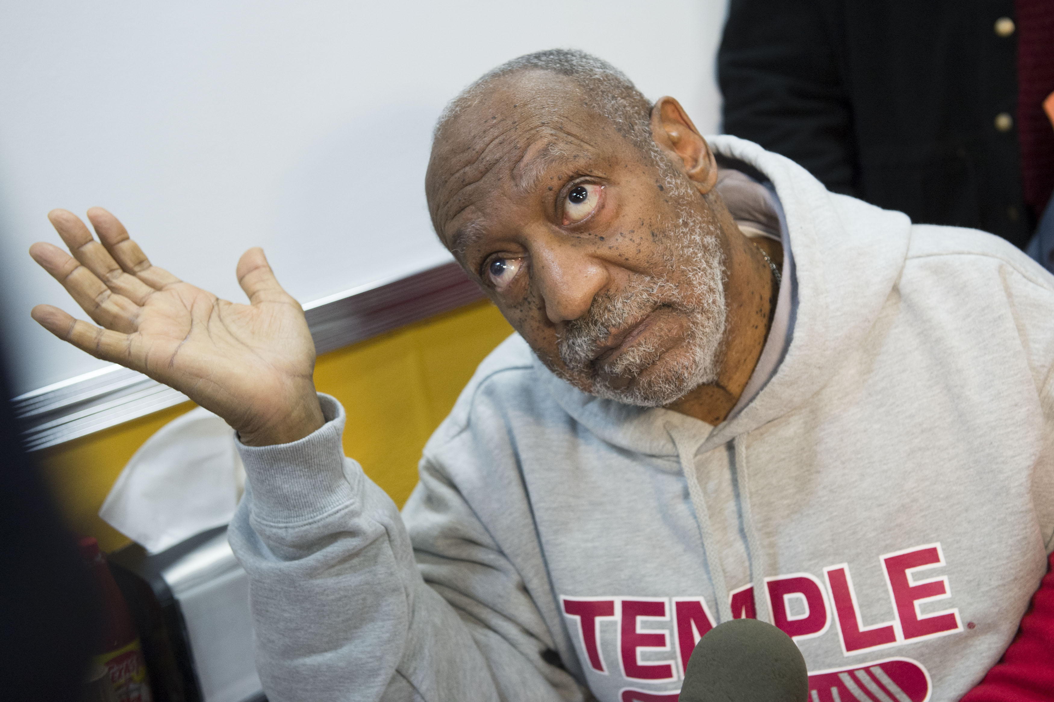 Image #: 27870838    Actor Bill Cosby talks to reporters at the grand opening of Ben's Chili Bowl on March 6, 2014, in Arling