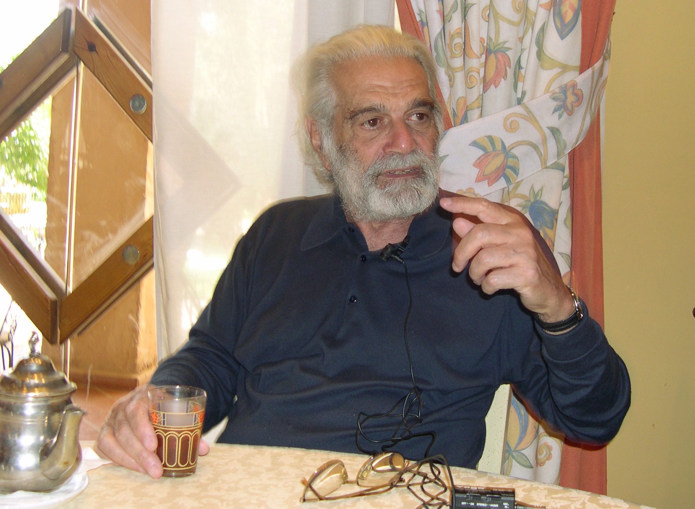 Egyptian-born movie legend Omar Sharif, 73, speaks while drink tea during an interview with The Associated Press at a hotel i