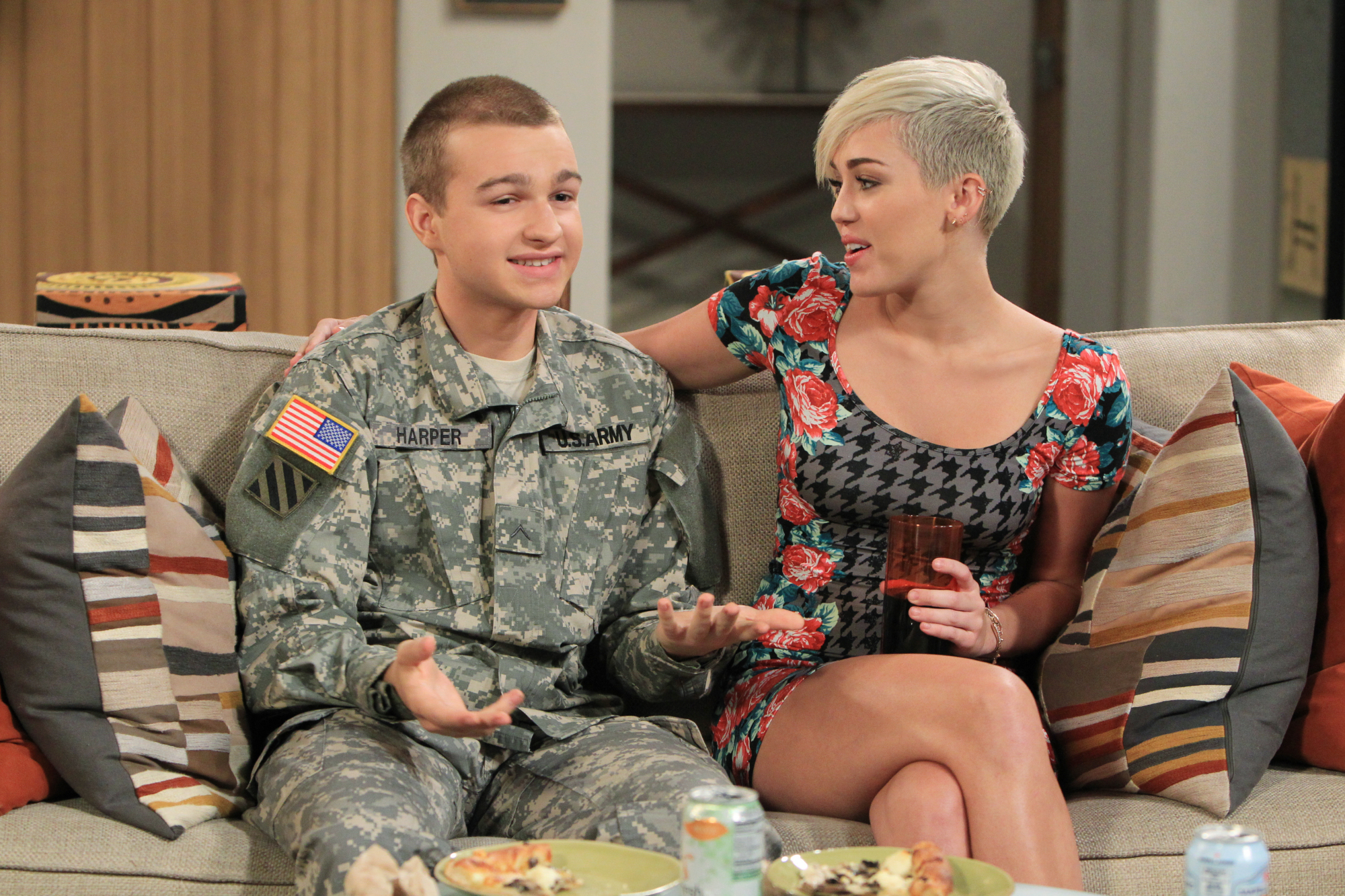 Image #: 19897367    'Avoid The Chinese Mustard' -- Jake (Angus T. Jones, left) and Missi (Miley Cyrus, right) plan a rendezv