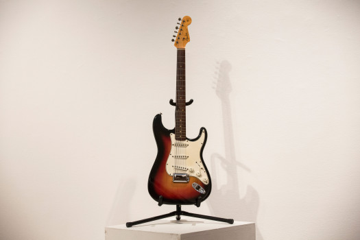 """NEW YORK, NY - NOVEMBER 25:  The Fender Stratocaster electric guitar played by musician Bob Dylan on July 25, 1965 at Newport Folk Festival, better known as """"the night Dyan went electric"""" is seen at an auction preview at Christie's on November 25, 2013 in New York City. The guitar is estimated at $300,000 to $500,000.  (Photo by Andrew Burton/Getty Images)"""