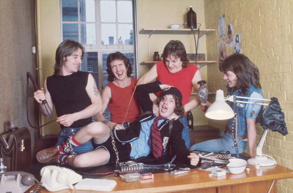 AC/DC group portrait, London, July 1976, L-R Phil Rudd, Bon Scott, Angus Young, Mark Evans, Malcolm Young. (Photo by Michael