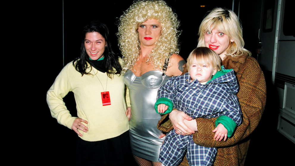 Kim Deal of the Pixies, Flea of Red Hot Chili Peppers, Courtney Love and daughter Frances Bean Cobain (Photo by Jeff Kravitz/