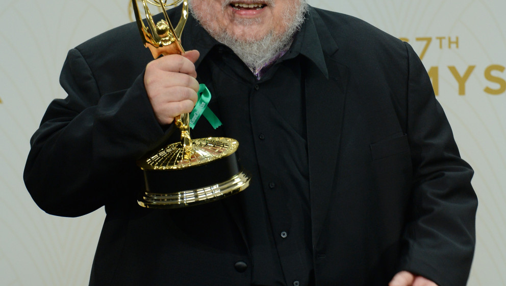Image #: 39558913    Writer George R. R. Martin, winner of Outstanding Drama Series for 'Game of Thrones' holds his Emmy at t