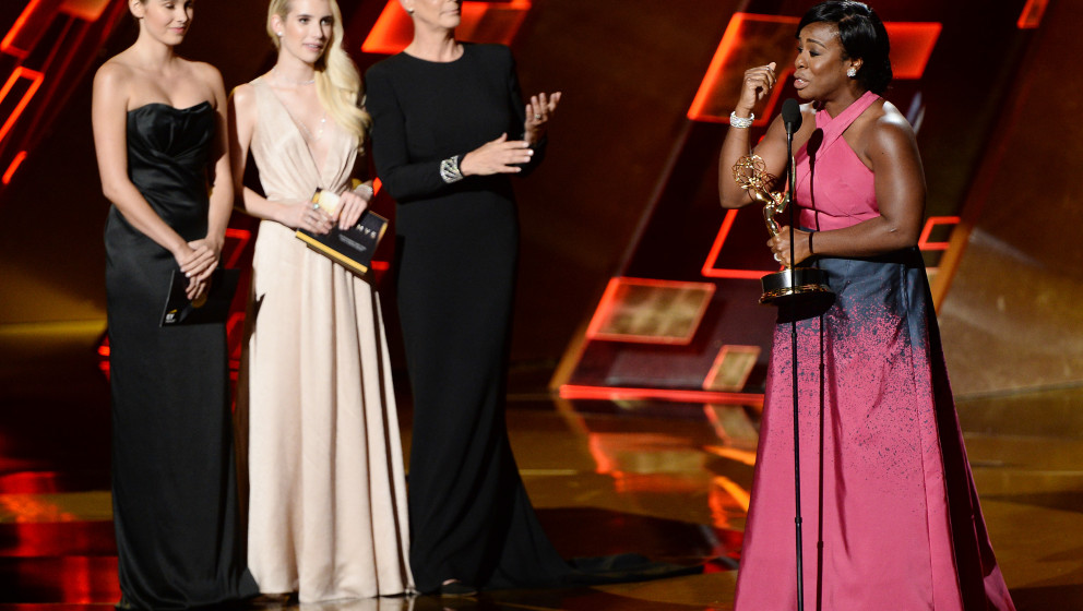Image #: 39557863    Actress Uzo Aduba (R) accepts the award for Outstanding Supporting Actress in a Drama Series for 'Orange