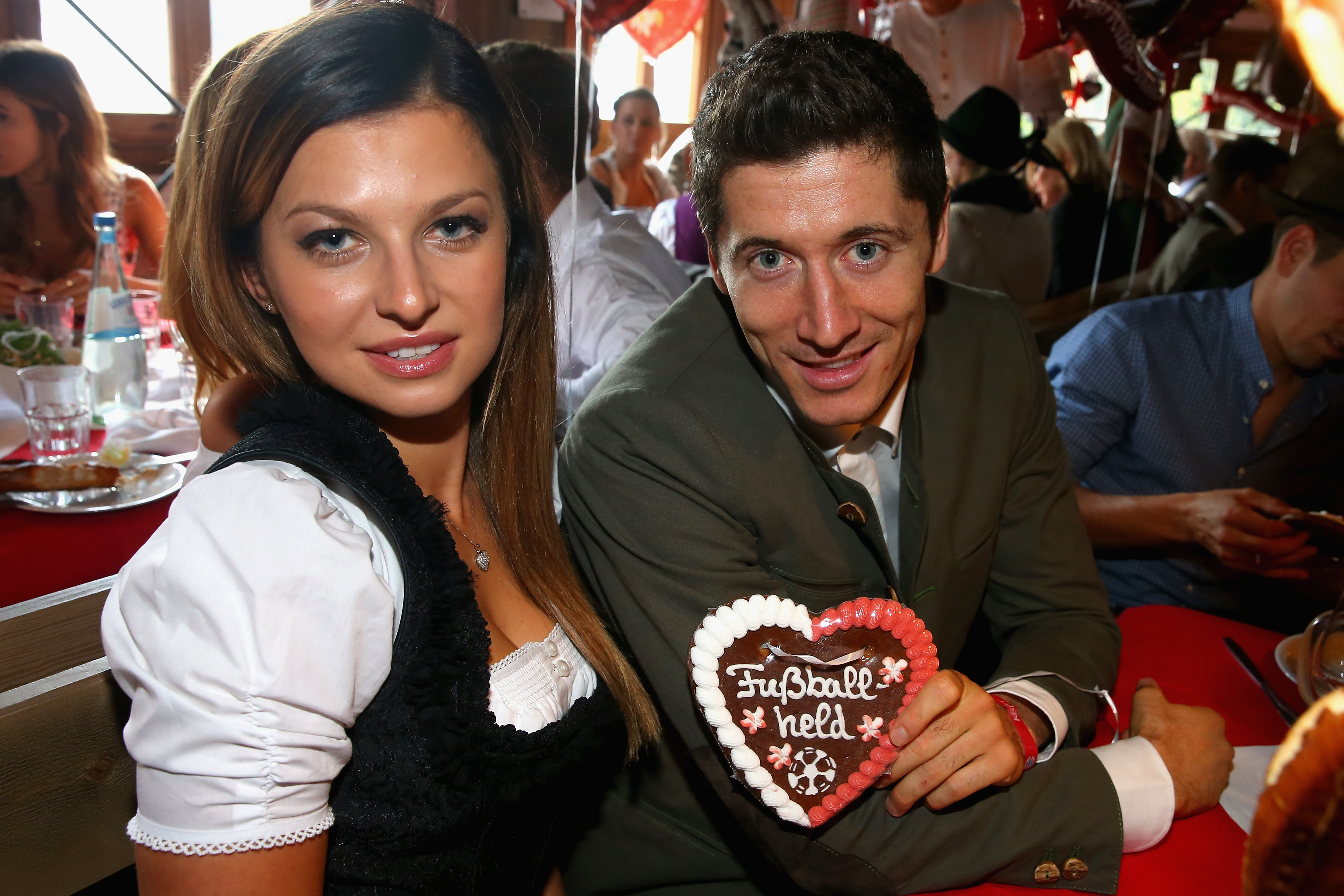 Bayern's Robert Lewandowski and his partner Anna Stachurska, left, pose for a photograph as the players of FC Bayern Munich v