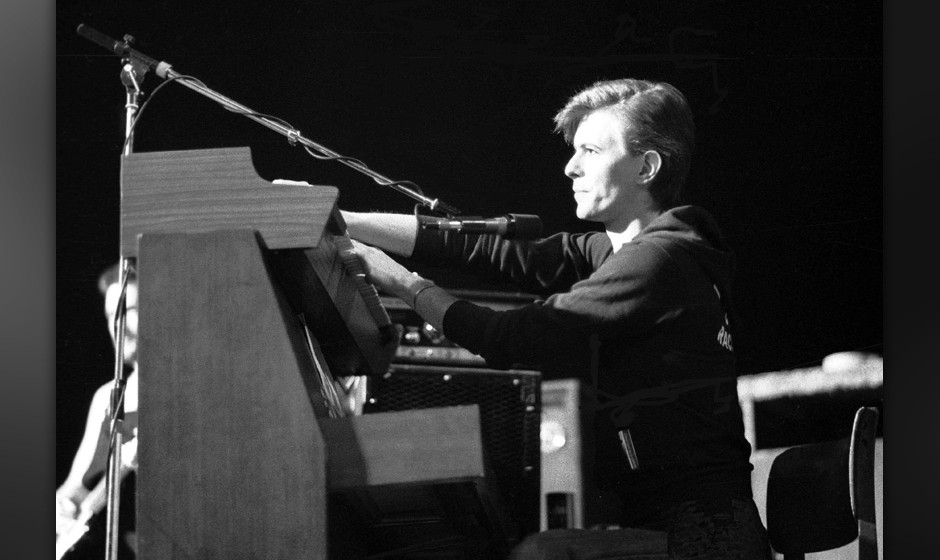 UNITED KINGDOM - MARCH 01:  RAINBOW THEATRE  Photo of David BOWIE, playing keyboards, performing live onstage in Iggy Pop's b