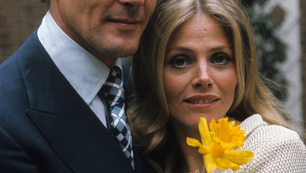 LONDON - APRIL 1:  Roger Moore and Britt Ekland pose on location for the filming of James Bond film 'The Man With The Golden