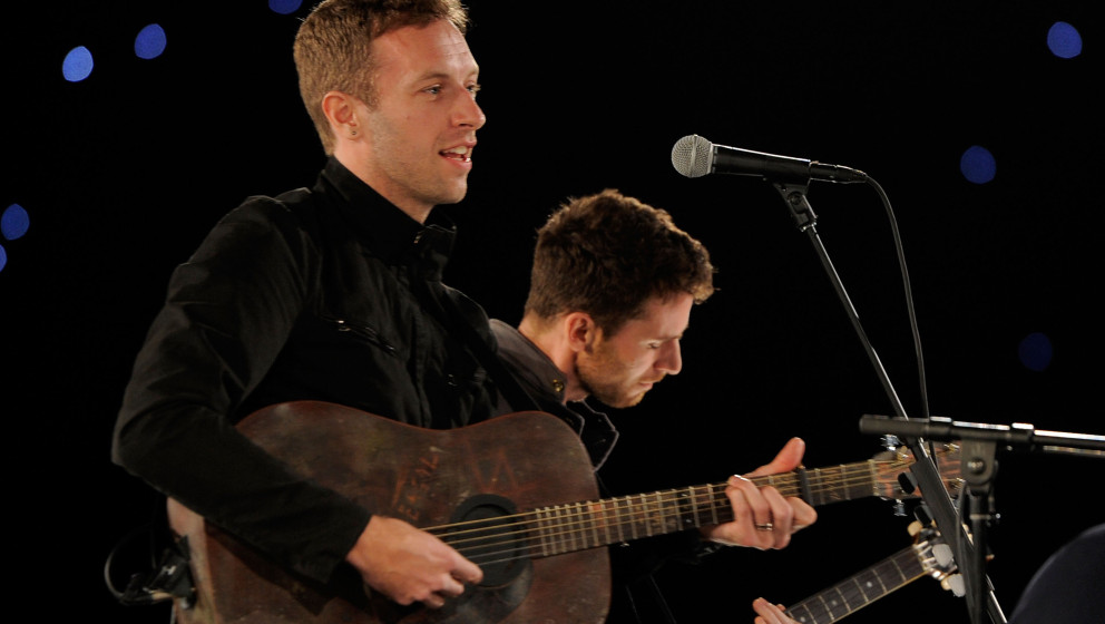 LOS ANGELES, CA - FEBRUARY 10:  Chris Martin (L) of the band Coldplay performs onstage at the 2012 MusiCares Person of the Ye
