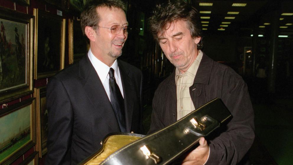 George Harrison (r.) und Eric Clapton im Jahr 1999