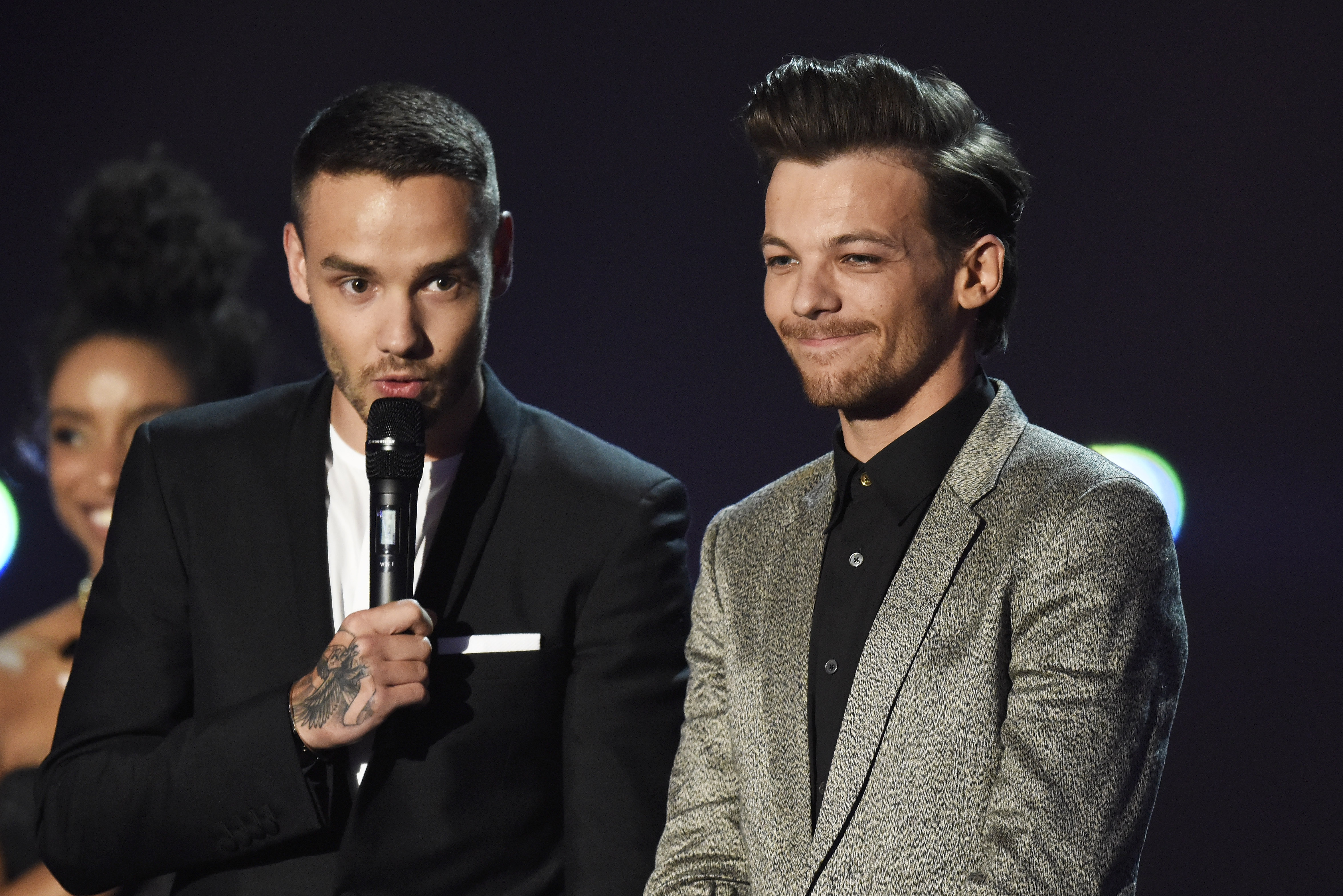 LONDON, ENGLAND - FEBRUARY 24:  Liam Payne and Louis Tomlinson from One Direction accept the award for British Artist Video a